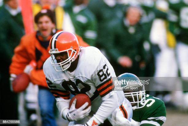 Tight End Ozzie Newsome of the Cleveland Browns gets dragged down from behind by Kevin McArthur of the New York Jets during an NFL football game...