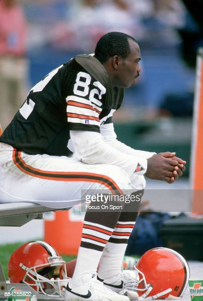 Tight End Ozzie Newsome of the Cleveland Browns looks on from the bench during an NFL football game circa 1990 at Cleveland Municipal Stadium in...