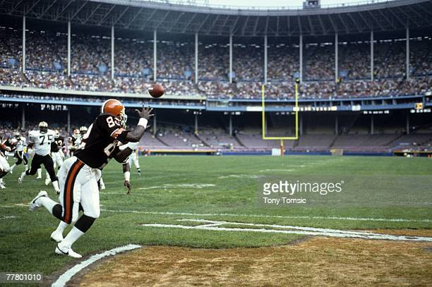 Tight end Ozzie NEwsome of the Cleveland Browns reaches out for a touchdown pass during a game on October 28 1984 against the New Orleans Saints at...