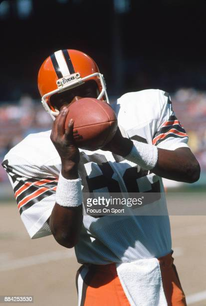 Tight End Ozzie Newsome of the Cleveland Browns warms up prior to the start of an NFL football game circa 1990 at Cleveland Municipal Stadium in...