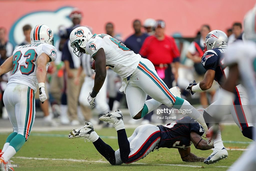 Tight end Randy McMichael #81 of the Miami Dolphins dives for yardage after catching a pass against the New England Patriots at Dolphin Stadium on December 10, 2006 in Miami, Florida. The Dolphins defeated the Patriots 21-0.