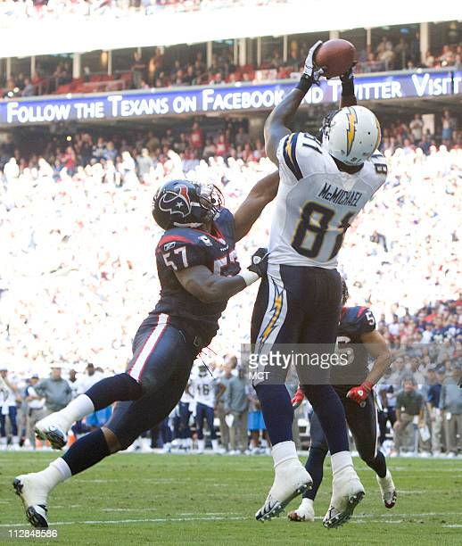 Tight end Randy McMichael of the San Diego Chargers pulls in a touchdown pass in front of linebacker Kevin Bentley of the Houston Texansin the first...
