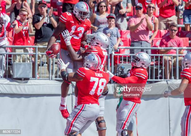 Tight end Rashod Berry of the Ohio State Buckeyes celebrates a touchdown during the game between the Ohio State Buckeyes and the UNLV Rebels on...
