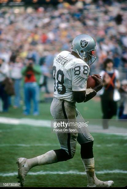 Tight End Raymond Chester of the Oakland Raiders catches a pass during an NFL football game circa 1979. Chester played for the Raiders from 1970-72...