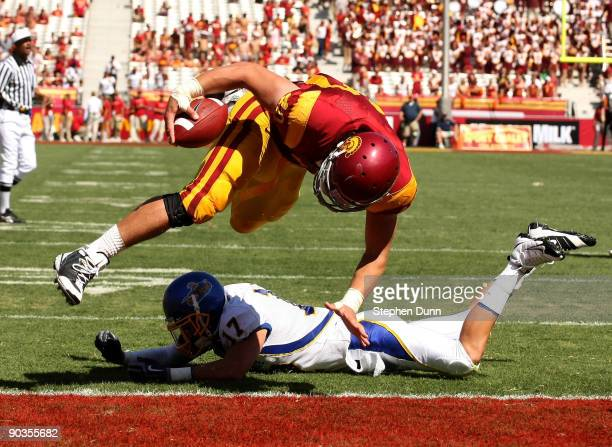 Tight end Rhett Ellison of the USC Trojans dives for a touchdown over safety Tanner Burns of the San Jose State Spartans on September 5, 2009 at the...