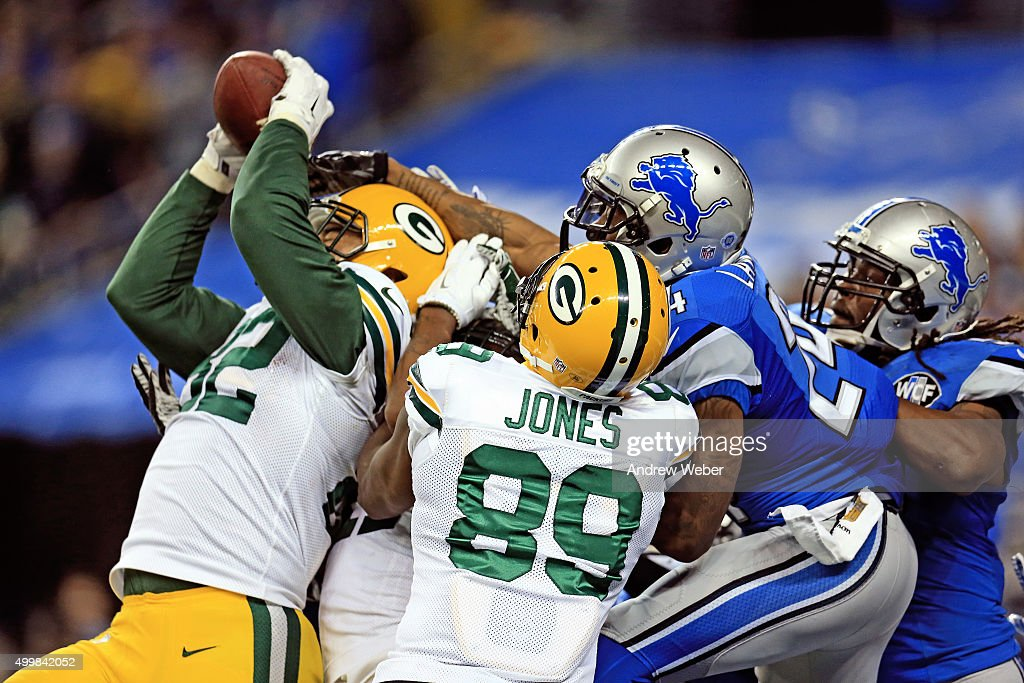Tight end Richard Rodgers #82 of the Green Bay Packers catches the game-winning touchdown as time expired to defeat the Detroit Lions 27-23 at Ford Field on December 3, 2015 in Detroit, Michigan.