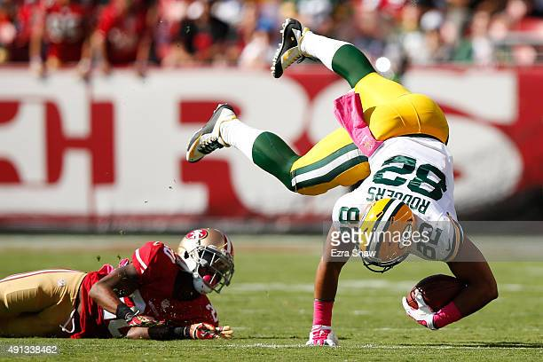 Tight end Richard Rodgers of the Green Bay Packers is tackled by cornerback Kenneth Acker of the San Francisco 49ers during their NFL game at Levi's...