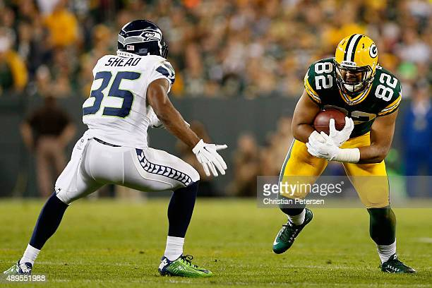 Tight end Richard Rodgers of the Green Bay Packers runs with the football during the NFL game against the Seattle Seahawks at Lambeau Field on...