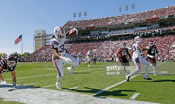 Tight end Ricky Jones of the Louisiana Tech Bulldogs tip toes down the sideline as he carries the ball during the second quarter of an NCAA college...