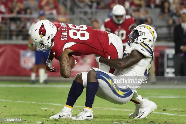 Tight end Ricky SealsJones of the Arizona Cardinals is tackled by linebacker Jatavis Brown of the Los Angeles Chargers after a reception during the...
