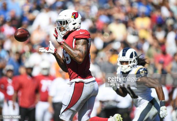 Tight end Ricky Seals-Jones of the Arizona Cardinals makes the catch in front of defensive back Marqui Christian of the Los Angeles Rams in the third...