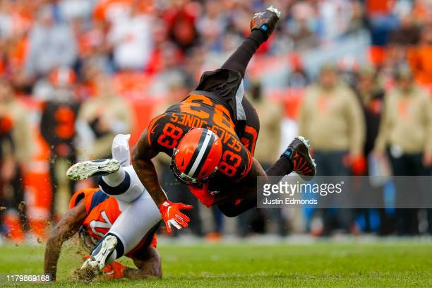 Tight end Ricky SealsJones of the Cleveland Browns is tackled by cornerback Kareem Jackson of the Denver Broncos during the second quarter at Broncos...