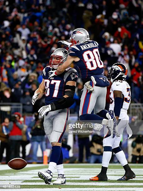 Tight end Rob Gronkowski celebrates a touchdown with Danny Amendola of the New England Patriots against the Denver Broncos during a game at Gillette...