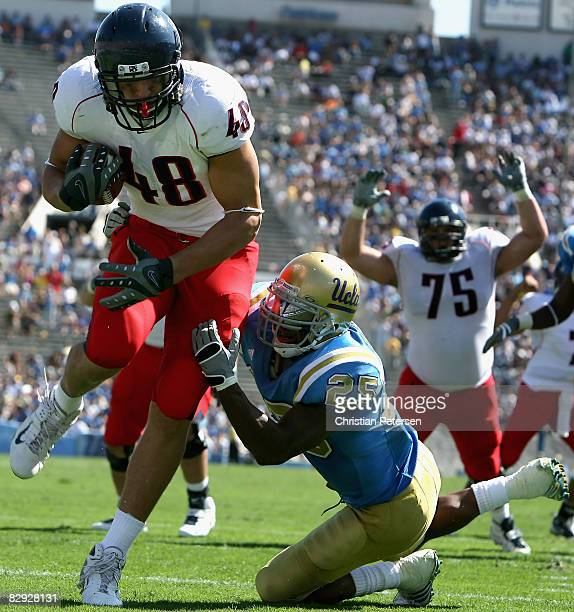 Tight end Rob Gronkowski of the Arizona Wildcats scores on a 4 yard touchdown reception past Bret Lockett of the UCLA Bruins during the fourth...