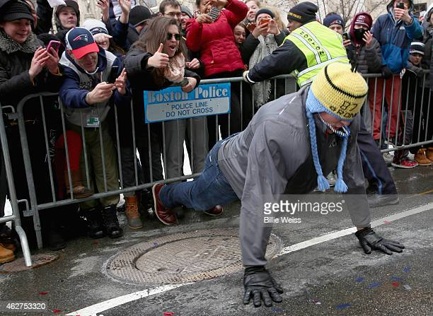 Tight end Rob Gronkowski of the New England Patriots does push ups during a Super Bowl victory parade on February 4 2015 in Boston Massachusetts The...