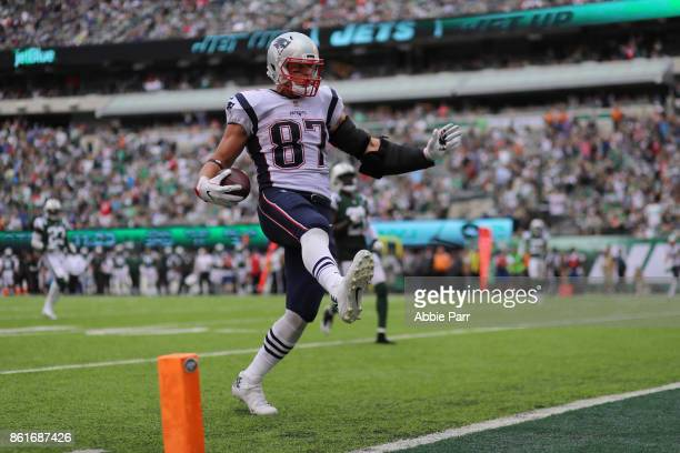 Tight end Rob Gronkowski of the New England Patriots scores a touchdown against the New York Jets during the second quarter of their game at MetLife...