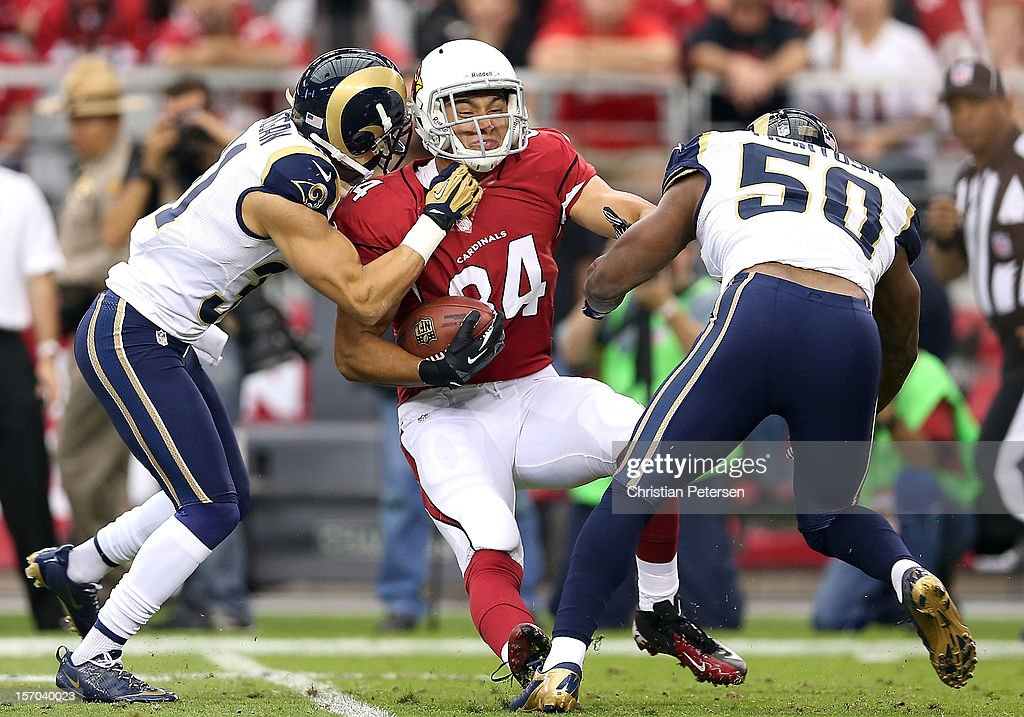 tight end Rob Housler #84 of the Arizona Cardinals is tackled after a reception against the St. Louis Rams during the NFL game at the University of Phoenix Stadium on November 25, 2012 in Glendale, Arizona. The Rams defeated the Cardinals 31-17.
