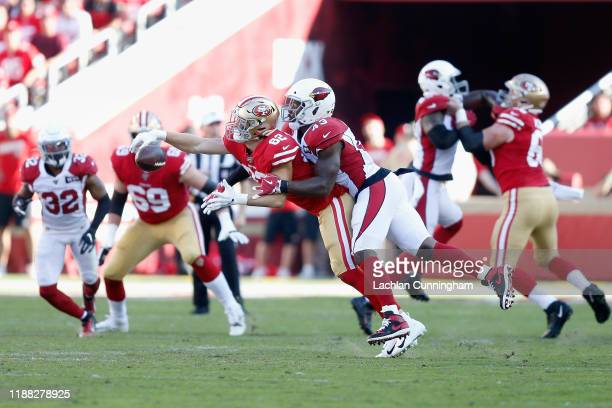 Tight end Ross Dwelley of the San Francisco 49ers attempts to catch a pass with pass interference called on linebacker Haason Reddick of the Arizona...