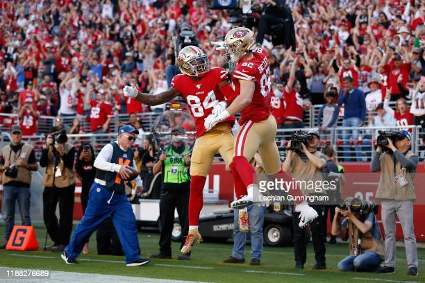 Tight end Ross Dwelley of the San Francisco 49ers celebrates with Kendrick Bourne after scoring a four yard touchdown reception against the Arizona...