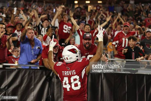 Tight end Ross Travis of the Arizona Cardinals celebrates after a 20-yard touchdown reception against the Kansas City Chiefs during the second half...