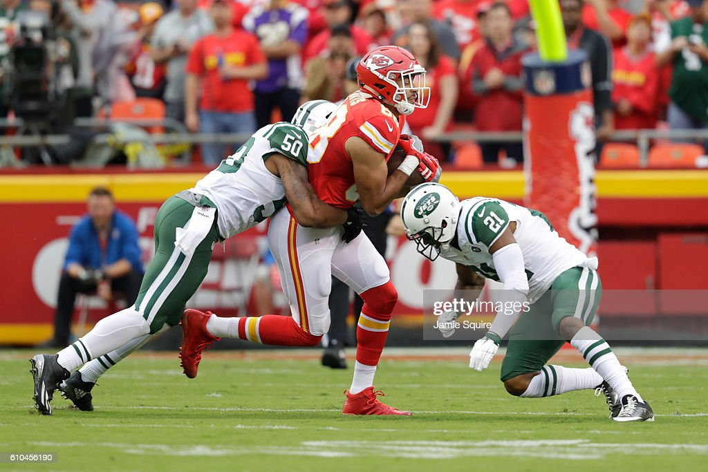 Tight end Ross Travis #88 of the Kansas City Chiefs is tackled by Marcus Gilchrist #21 and outside linebacker Darron Lee #50 of the New York Jets at Arrowhead Stadium during the first quarter of the game on September 25, 2016 in Kansas City, Missouri.