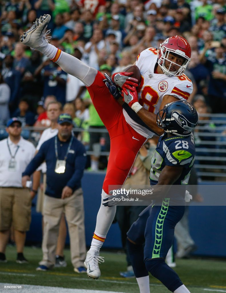 Tight end Ross Travis #88 of the Kansas City Chiefs makes a catch in the end zone against cornerback Pierre Desir #28 of the Seattle Seahawks at CenturyLink Field on August 25, 2017 in Seattle, Washington. Travis was ruled out of bounds on the play.