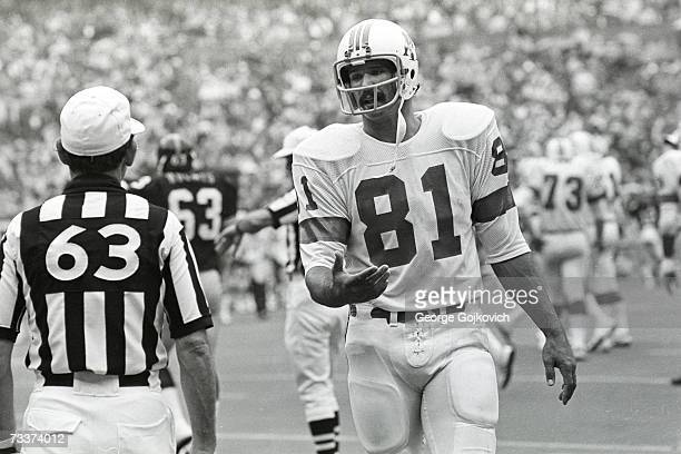 Tight end Russ Francis of the of the New England Patriots talks with an official during a game against the Pittsburgh Steelers at Three Rivers...