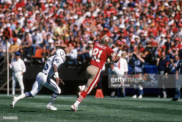 Tight end Russ Francis of the San Francisco 49ers catches a pass against safety Nesby Glasgow of the Indianapolis Colts during a game at Candlestick...