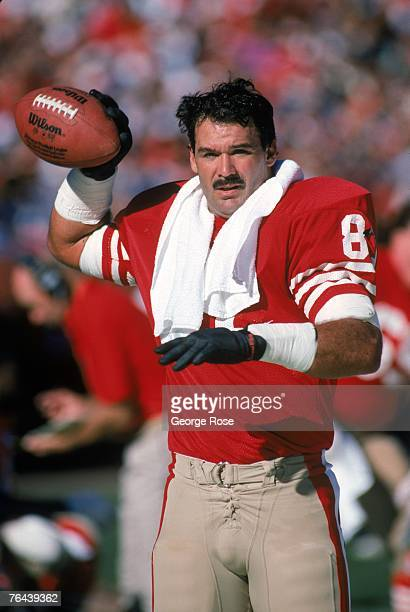 Tight end Russ Francis of the San Francisco 49ers warmsup on the sideline during a game against the New Orleans Saints at Candlestick Park on...