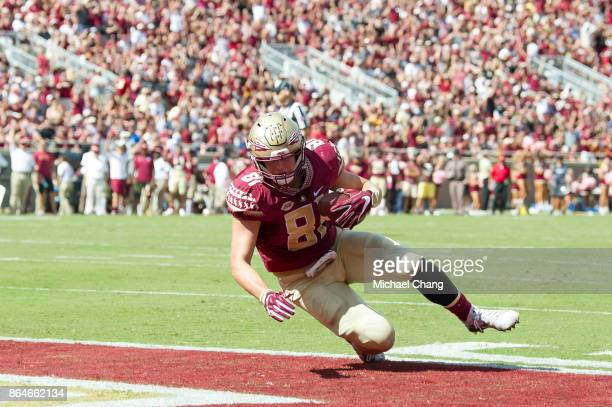 Tight end Ryan Izzo of the Florida State Seminoles catches a pass in the enzone for a touchdown during their game against the Louisville Cardinals at...