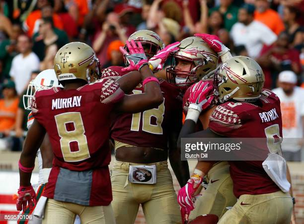 Tight end Ryan Izzo of the Florida State Seminoles celebrates with teammates after a touchdown during the second half of an NCAA football game...