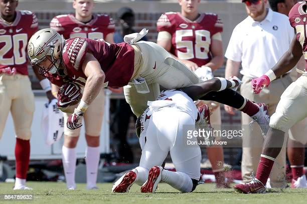 Tight End Ryan Izzo of the Florida State Seminoles dives for extra yardage during the game against the Louisville Cardinals at Doak Campbell Stadium...