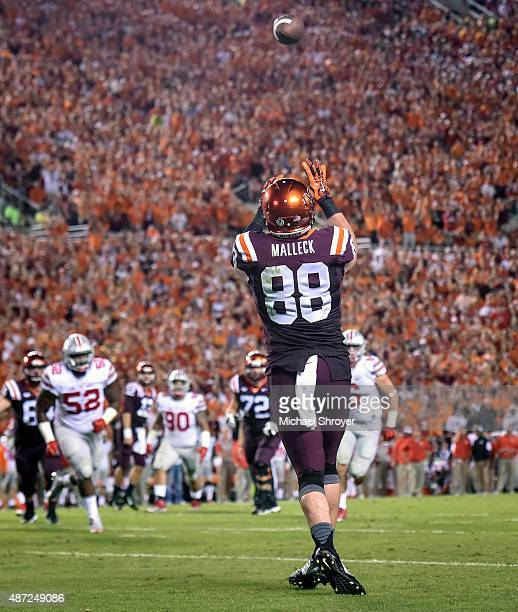 Tight end Ryan Malleck of the Virginia Tech Hokies catches a touchdown pass against the Ohio State Buckeyes in the first half at Lane Stadium on...