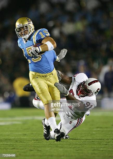 Tight End Ryan Moya of the UCLA Bruins breaks a tackle by Pannel Egboh of the Stanford Cardinal on September 30 2006 at the Rose Bowl in Pasadena...