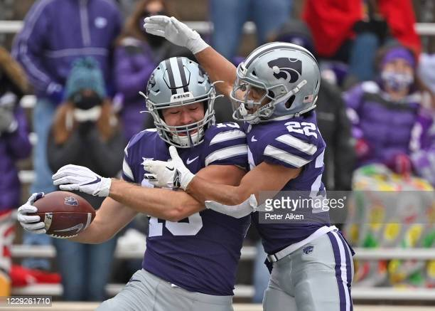 Tight end Samuel Wheeler of the Kansas State Wildcats celebrates with running back Deuce Vaughn, after scoring a touchdown during the first half...