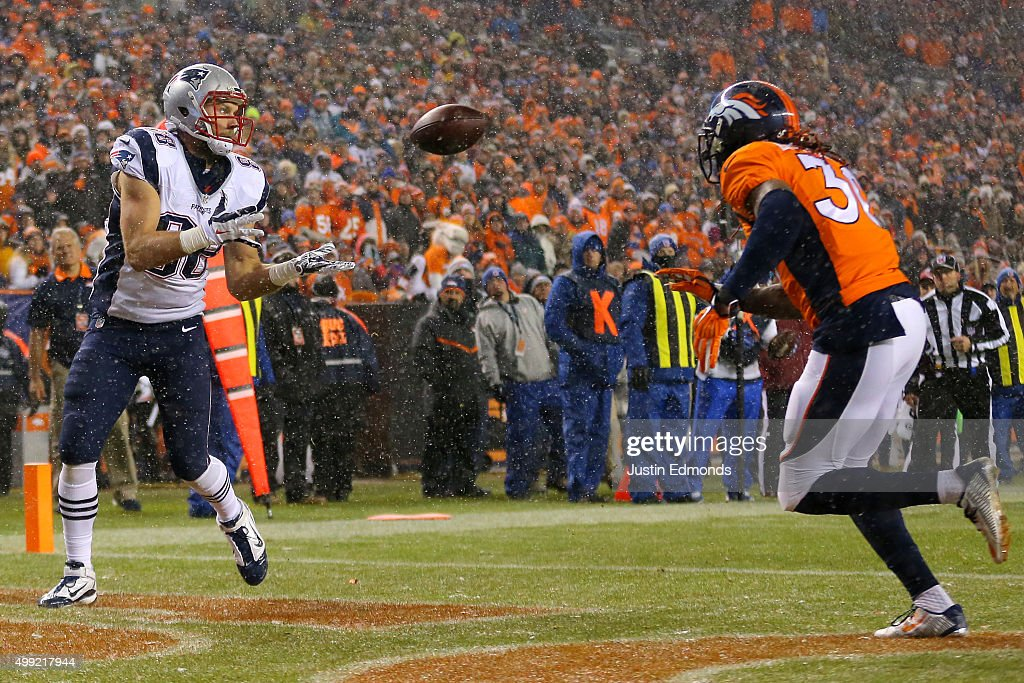 Tight end Scott Chandler #88 of the New England Patriots scores a second quarter touchdown past strong safety David Bruton #30 of the Denver Broncos at Sports Authority Field at Mile High on November 29, 2015 in Denver, Colorado.