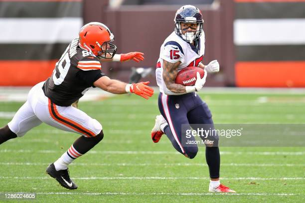Tight end Stephen Carlson of the Cleveland Browns tries to tackle wide receiver Will Fuller of the Houston Texans runs for a gain after a reception...
