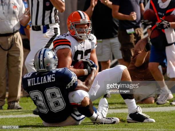 Tight end Steve Heiden of the Cleveland Browns is tackled by safety Roy Williams of the Dallas Cowboys during a game on September 7 2008 at the...