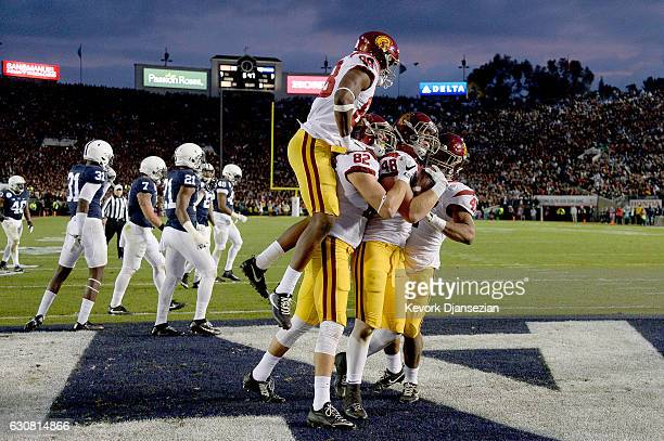 Tight end Taylor McNamara of the USC Trojans celebrates with teammates after scoring a two point conversion in the third quarter against the Penn...