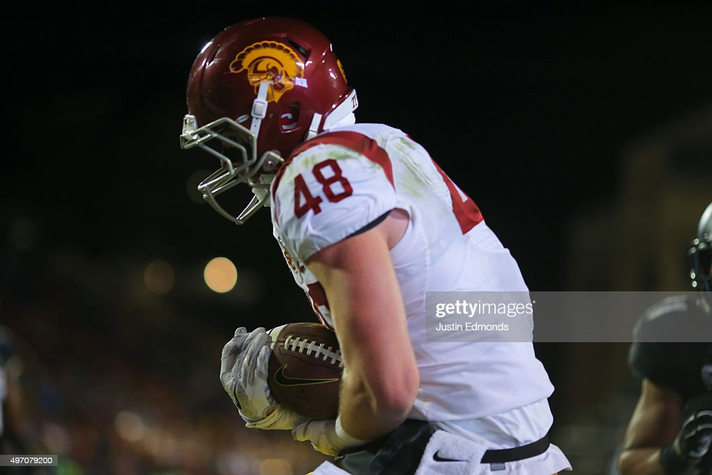 Tight end Taylor McNamara #48 of the USC Trojans scores a third quarter touchdown against the Colorado Buffaloes at Folsom Field on November 13, 2015 in Boulder, Colorado. The Trojans defeated the Buffaloes 27-24.
