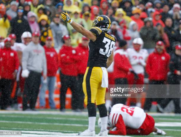 Tight end TJ Hockenson of the Iowa Hawkeyes signals a first down late in the second half in front of safety Antonio Reed of the Nebraska Cornhuskers...