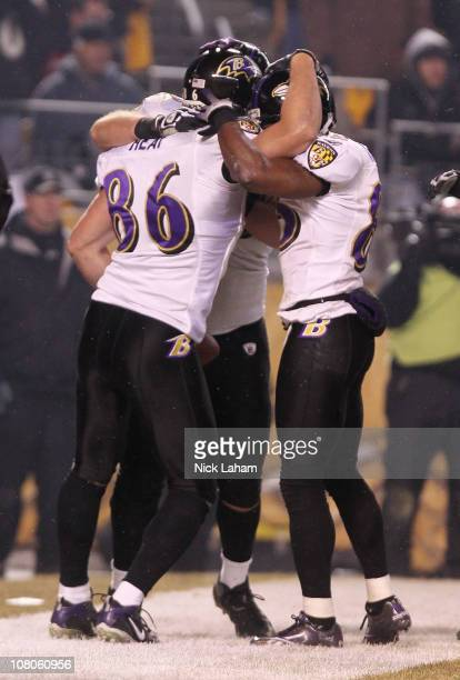 Tight end Todd Heap of the Baltimore Ravens celebrates with teammates after scoring on a fouryard touchdown pass against the Pittsburgh Steelers in...
