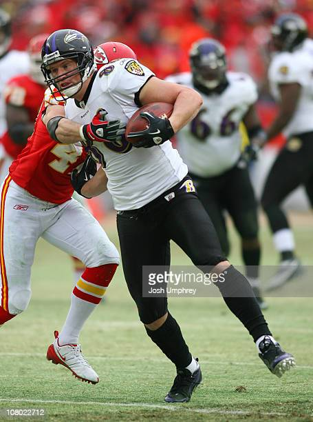 Tight end Todd Heap of the Baltimore Ravens shakes off a tackle from safety Jon McGraw of the Kansas City Chiefs at Arrowhead Stadium on January 9...