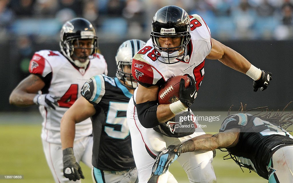 Tight end Tony Gonzalez #88 of the Atlanta Falcons breaks a tackle during the game against the Carolina Panthers at Bank of America Stadium on December 11, 2011 in Charlotte, North Carolina.