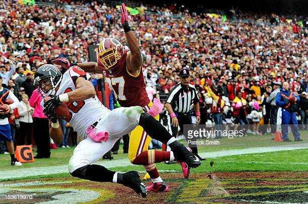 Tight end Tony Gonzalez of the Atlanta Falcons catches a pass for a touchdown past linebacker Lorenzo Alexander of the Washington Redskins in the...