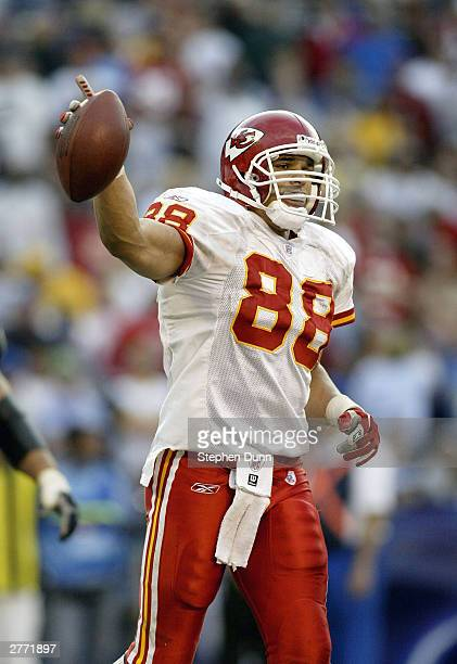 Tight end Tony Gonzalez of the Kansas City Chiefs celebrates his second touchdown catch against the San Diego Chargers on November 30 2003 at...