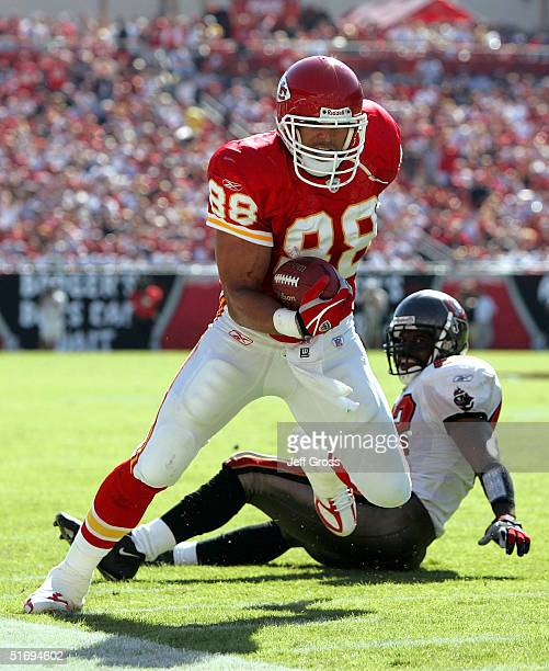 Tight end Tony Gonzalez of the Kansas City Chiefs completes a pass in front of Ian Gold of the Tampa Bay Buccaneers at Raymond James Stadium on...