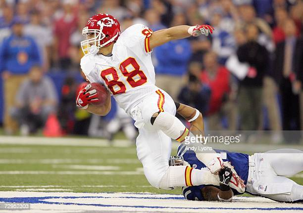 Tight end Tony Gonzalez of the Kansas City Chiefs is tackled by Antoine Bethea of the Indianapolis Colts during their AFC Wild Card Playoff Game...