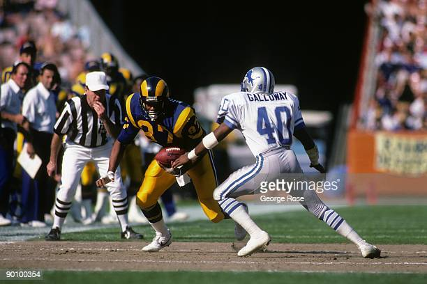 Tight end Tony Hunter of the Los Angeles Rams looks to make a play against defensive back Duane Galloway of the Detroit Lions during the game at...