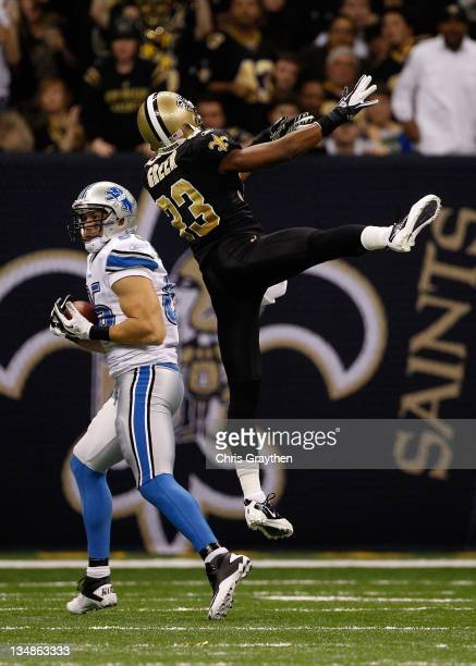 Tight end Tony Scheffler of the Detroit Lions makes a 36 yard catch as cornerback Jabari Greer of the New Orleans Saints defends in the third quarter...
